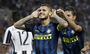 Inter Milan's Mauro Icardi celebrates after scoring during the Serie A soccer match between Inter Milan and Juventus at the San Siro stadium in Milan, Italy, Sunday, Sept. 18, 2016. (ANSA/AP Photo/Antonio Calanni) [CopyrightNotice: Copyright 2016 The Associated Press. All rights reserved.]