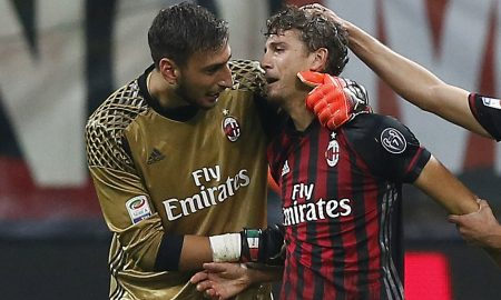 AC Milan's midfielder Manuel Locatelli (2ndL) celebrates with teammates after scoring during the Italian Serie A football match AC Milan vs Sassuolo on October 2, 2016 at the San Siro stadium in Milan.  / AFP / MARCO BERTORELLO        (Photo credit should read MARCO BERTORELLO/AFP/Getty Images)