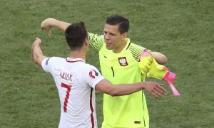 Poland's Arkadiusz Milik, left, and goalkeeper Wojciech Szczesny celebrate after winning 1-0 during the Euro 2016 Group C soccer match between Poland and Northern Ireland, at the Allianz Riviera stadium, in Nice, France, Sunday, June 12, 2016. (AP Photo/Claude Paris)