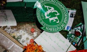 epa05652359 Supporters of the Brazilian soccer team Chapecoense leave flowers and condolence letters during a gathering of supporters at the Arena Conda Arena in Chapeco, Brazil, 29 November 2016, to perform a vigil in honor of the victims of the plane crash in La Union, department of Antioquia, Colombia. According to reports, 75 people died when an aircraft crashed late 28 November 2016 with 81 people on board, including players of the Brazilian soccer club Chapecoense. The plane crashed in a mountainous area outside Medellin, Colombia as it was approaching the Jose Maria Cordoba airport. The cause of the incident is as yet uknown. Chapecoense were scheduled to play in the Copa Sudamericana final against Medellin's Atletico Nacional on 30 November 2016.  EPA/Fernando Bizerra Jr.