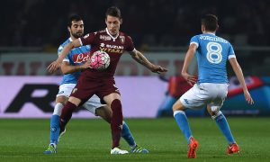 TURIN, ITALY - MAY 08:  Andrea Belotti (C) of Torino FC is challenged by Raul Albiol (L) of SSC Napoli during the Serie A match between Torino FC and SSC Napoli at Stadio Olimpico di Torino on May 8, 2016 in Turin, Italy.  (Photo by Valerio Pennicino/Getty Images)