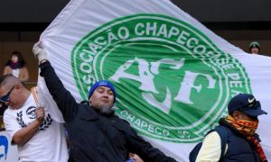 Supporters of Club America unfurl a flag of Chapecoense before their match against Jeonbuk Motors at the FIFA Club World Cup soccer tournament at Suita City Football Stadium in Suita, western Japan, Sunday, Dec. 11, 2016. An airplane crash on Nov. 28, 2016 killed most of passengers, including most of the Brazilian football team Chapecoense. (ANSA/AP Photo/Eugene Hoshiko) [CopyrightNotice: Copyright 2016 The Associated Press. All rights reserved.]