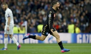 epa05795712 Napoli's striker Lorenzo Insigne jubilates after scoring the 0-1 goal during the UEFA Champions League round of 16 first leg soccer match between Real Madrid and SSC Napoli at Santiago Bernabeu stadium in Madrid, Spain, 15 February 2017.  EPA/JUANJO MARTIN