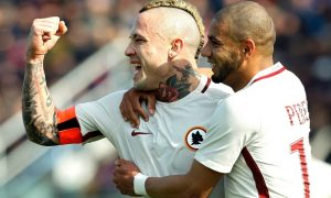 Roma's Belgian midfielder Radja Nainggolan (L) celebrates after scoring with teammate Roma's Brazilian defender Bruno Peres during the Italian Serie A football match FC Crotone vs AS Roma on February 12, 2017 at the Ezio Scida Stadium / AFP / CARLO HERMANN        (Photo credit should read CARLO HERMANN/AFP/Getty Images)