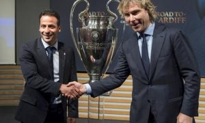 epa05919273 AS Monaco former player Ludovic Giuly (L) shakes hands with vice-president of Juventus Football Club Pavel Nedved (R) in front of the Champions League trophy during the semi final draw of the UEFA Champions League 2016/17, at the UEFA Headquarters, in Nyon, Switzerland,  21 April 2017.  EPA/JEAN-CHRISTOPHE BOTT