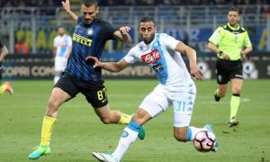 Inter's Antonio Candreva (L) and Napoli's Faouzi Ghoulam in action during the Italian Serie A soccer match Inter FC vs SSC Napoli at Giuseppe Meazza stadium in Milan, Italy, 30 April 2017. ANSA/MATTEO BAZZI